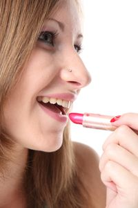 Girl Applying Pink Lipstick